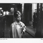 sad eyed model in this street of merry making, 1962, hand printed fiber base silver gelatin print